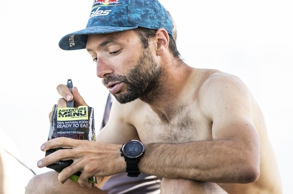 Gaspard Petiot (FRA2) eats during the Red Bull X-Alps in Barcelonnette, France on June 26, 2019