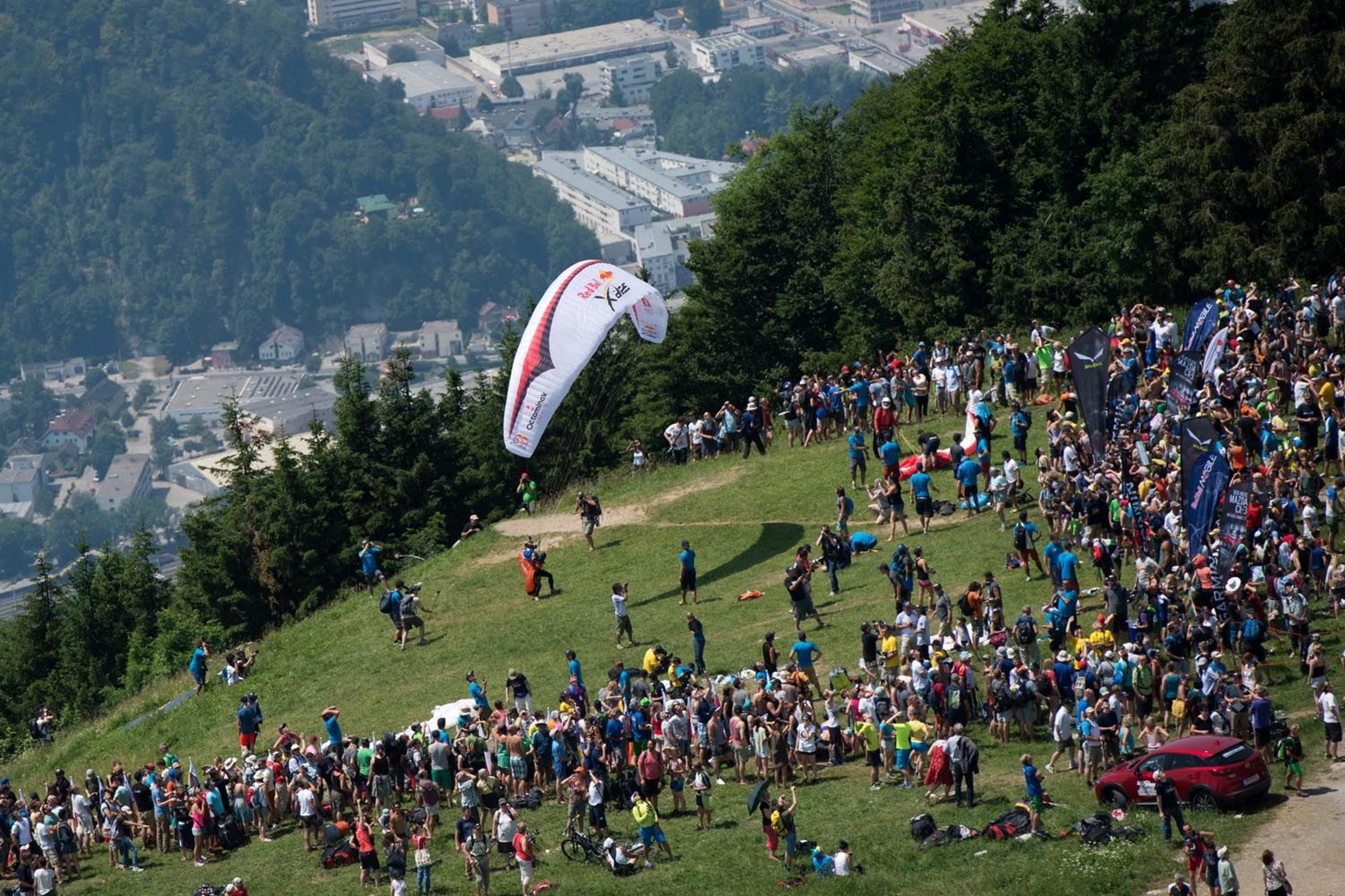 Competitors perform at the Gaisberg Mountain during the adventure race Red Bull X-Alps in Salzburg, on July 5th, 2015.