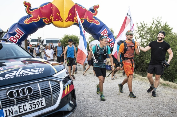 Paul Guschlbauer (AUT1) and Benoit Outters (FRA1) cross the finish line during the Red Bull X-Alps in Peille, France on June 26, 2019