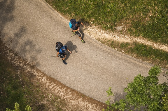 Christian Maurer (SUI1) and Paul Guschlbauer (AUT1) hike during the Red Bull X-Alps in Aschau, Germany on June 17, 2019.