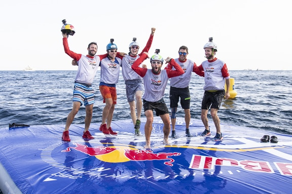 Tom De Dorlodot (BEL), Patrick Von Kanel (SUI2), Simon Oberrauner (AUT2), Gaspard Petiot (FRA2), Aaron Durogati (ITA1) and Manuel Nuebel (GER1) celebrate during the Red Bull X-Alps in Roquebrune, France on June 27, 2019