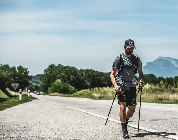 Tom De Dorlodot (BEL) walkes through the villages of Barraux, France at the Red Bull X-Alps on June 24, 2019